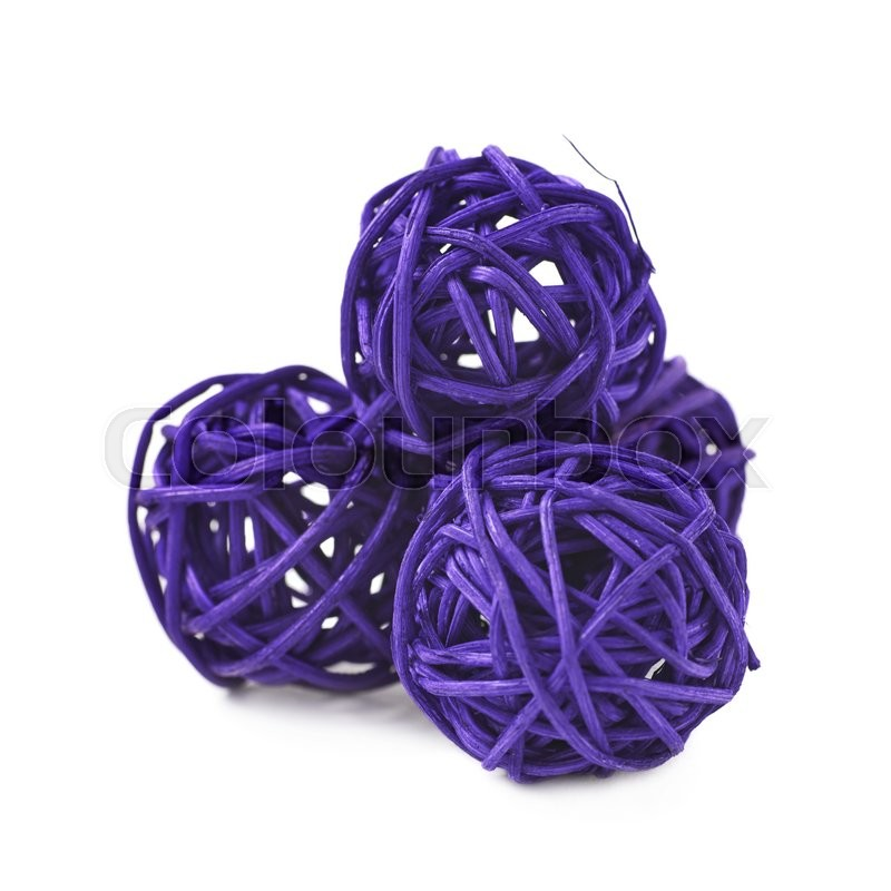 Pile of decorative colored straw balls isolated over the