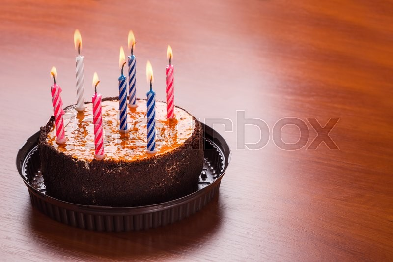Birthday Cake With Candles Stands On The Table Stock Photo Colourbox