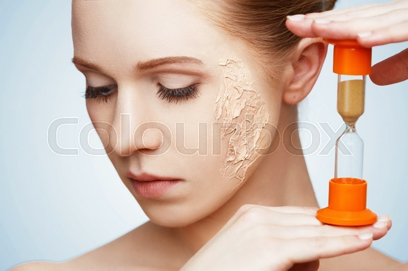 Beauty concept rejuvenation, renewal, skin care and skin problems with hourglass, stock photo