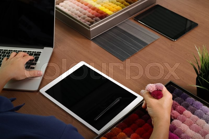 Top View Of Interior Designer Hand Chosing Carpet Sample With Blank New Modern Computer Laptop And Pro Digital Tablet Material Board Design