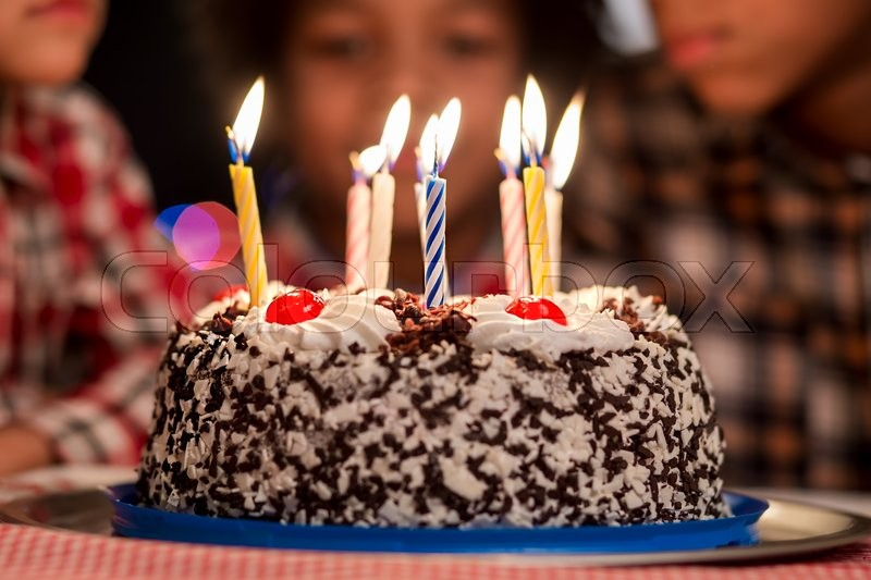 Cake In Front Of Kids Small Birthday With Candles Cant Wait To Eat This Its A Very Special Holiday Stock Photo
