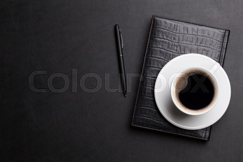 Office leather desk table with coffee cup, notepad and pen. Top view with copy space, stock photo