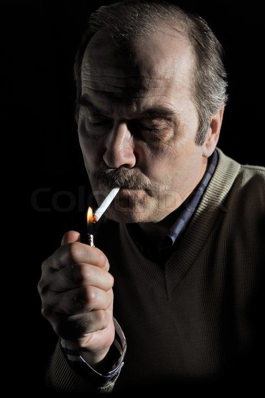 Studio portrait of a mustached man lighting cigarette over black | Stock Photo | Colourbox  sc 1 st  Colourbox & Studio portrait of a mustached man lighting cigarette over black ... azcodes.com