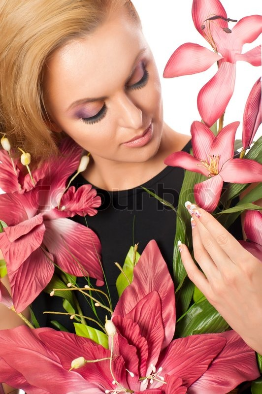 Portrait of young beautiful woman holding flowers isolated ...