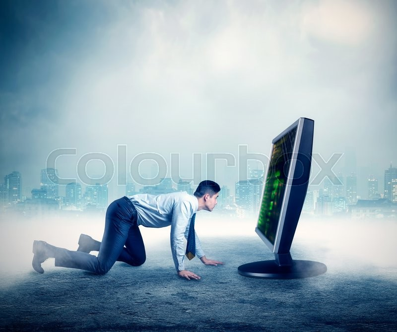 Businessman on all fours in front of the computer, stock photo