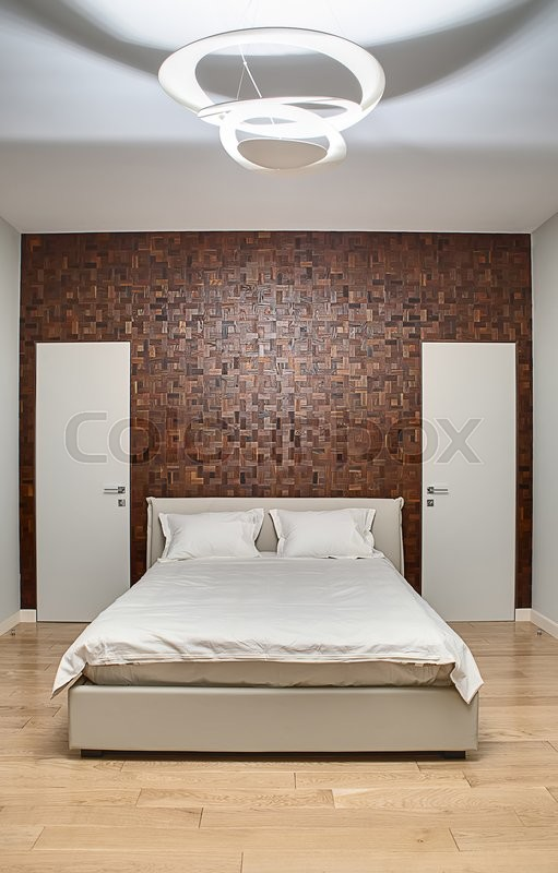 bedroom in a modern style with light walls on the back