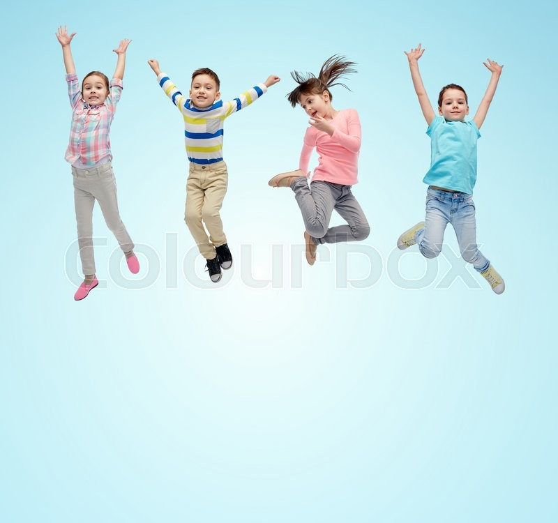 Happiness, childhood, freedom, movement and people concept - happy little children jumping in air over blue background, stock photo