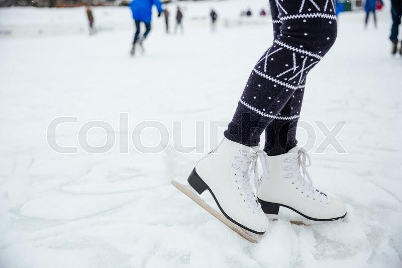 Closeup portrait of a female legs in ice skates, stock photo