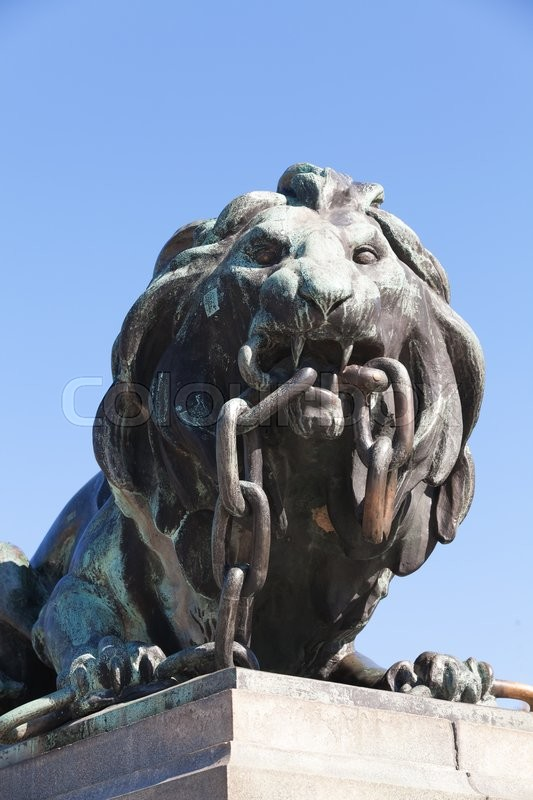 Ruse, Bulgaria   September 29, 2014: Outdoor Bronze Statue Of Lion Breaking  Thick Chain | Stock Photo | Colourbox