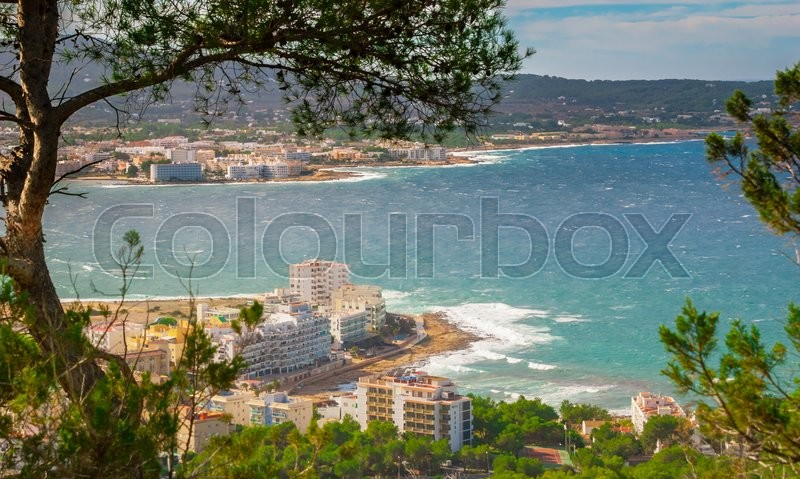 Hill side view of the city - St Antoni de Portmany and surrounding area in Ibiza, on a clearing day in November, kindly warm breeze in autumn, Balearic Islands, Spain, stock photo