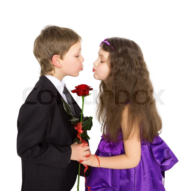 Kids love concept little boy and girl kissing and holding rose little boy and girl kissing and holding rose flower isolated on white background stock photo colourbox altavistaventures Images