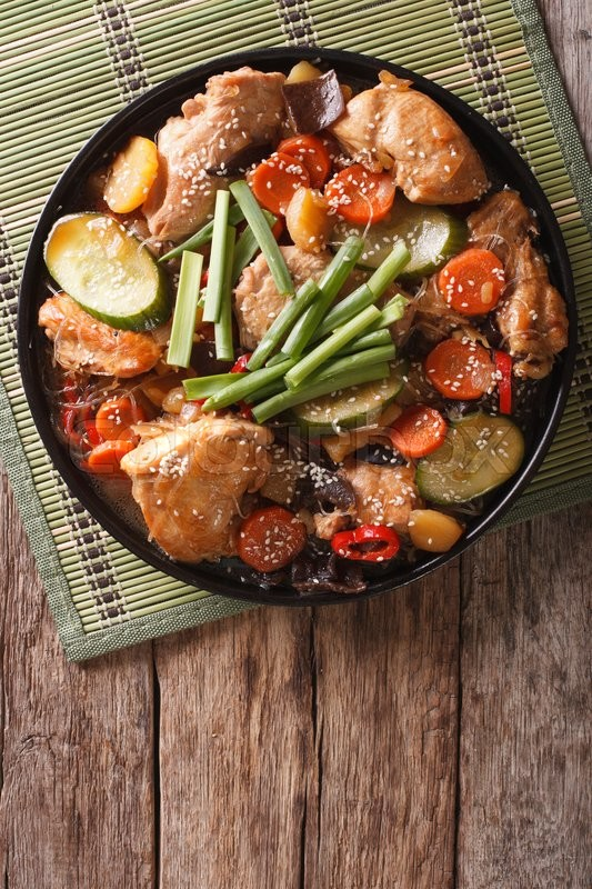 Korean Food Jjimdak Stewed Chicken With Vegetables On A Plate Vertical View From Above