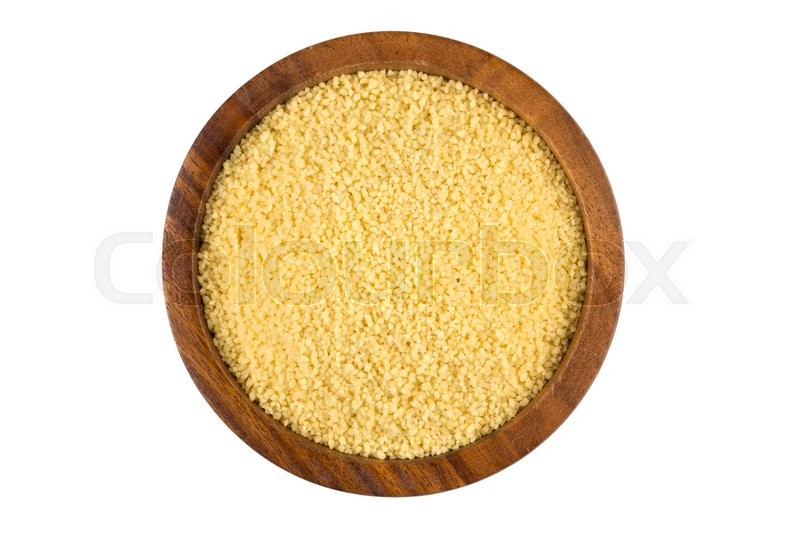 Raw couscous in a wooden bowl on white background | Stock ...