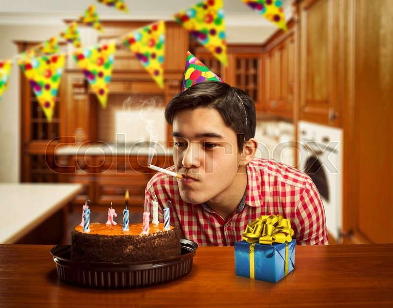 Sad Birthday Boy Smoking In A Kitchen Stock Photo