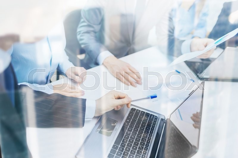 Business and office concept - close up of business team with files and laptop computer in office, stock photo