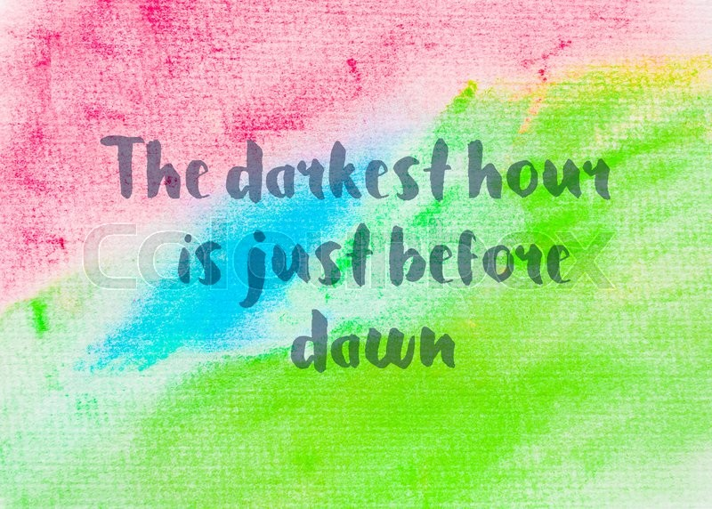 The darkest hour is just before dawn. Inspirational quote over abstract water color textured background, stock photo