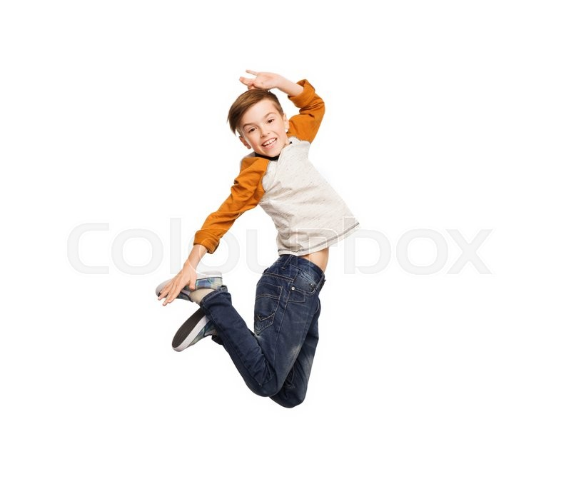 Happiness, childhood, freedom, movement and people concept - happy smiling boy jumping in air, stock photo