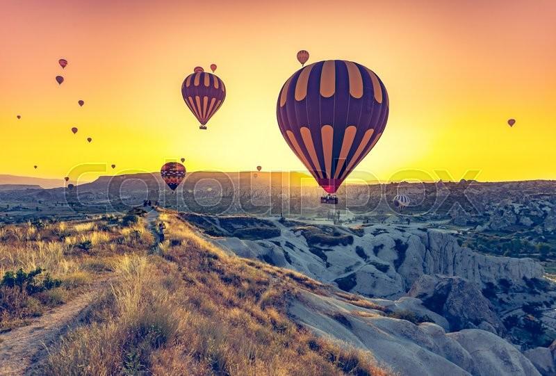 Hot air balloons flying over spectacular Cappadocia, stock photo