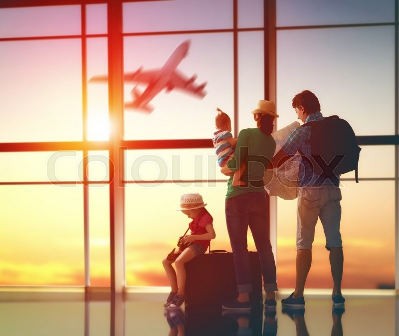 Happy family with suitcases in the airport. , stock photo