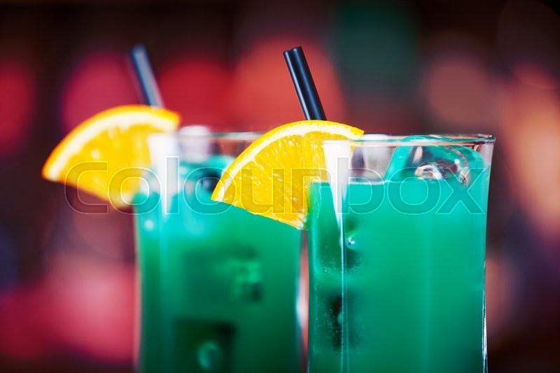 Ingredients: 3 oz vodka 1 oz Blue Curacao liqueur 1 splash cranberry juice 1 dash lime juice, stock photo