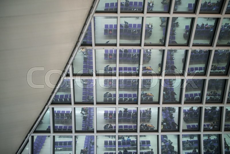 Stock image of 'waiting in airport reflection from the glass roof'