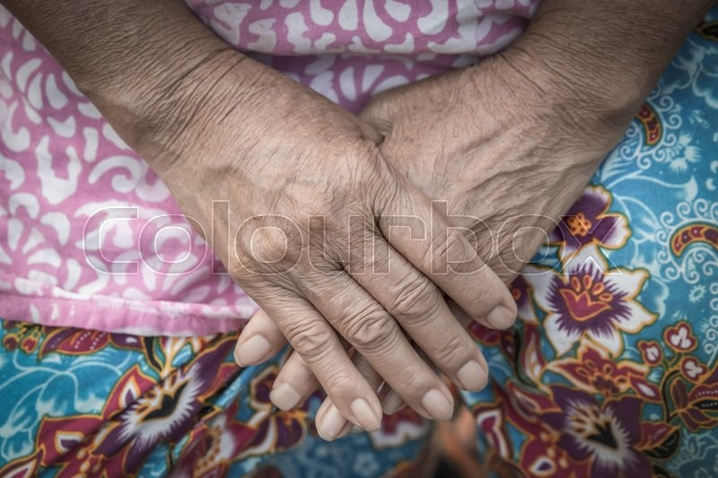 Aging process - very old senior woman hands wrinkled skin, stock photo