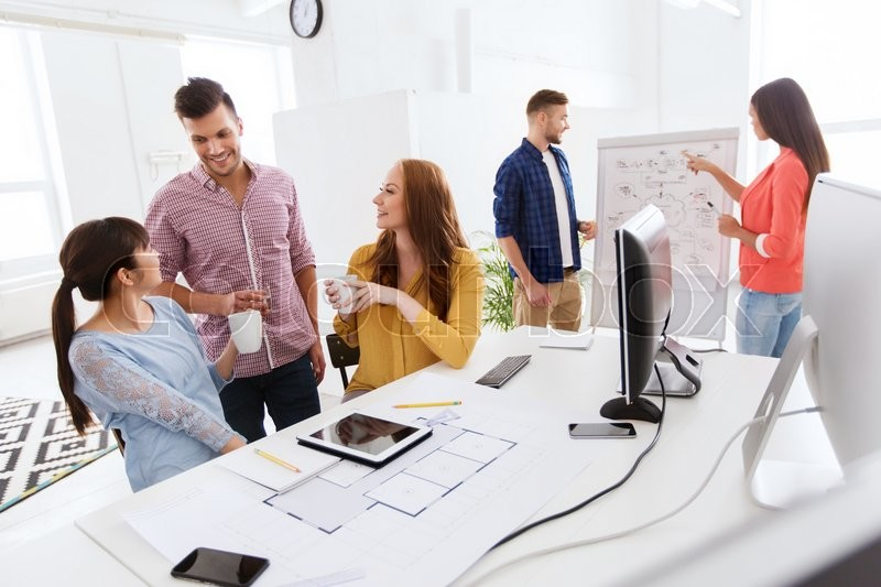 Business communication startup and people concept happy creative business communication startup and people concept happy creative architect team or students with blueprint drinking coffee at office stock photo malvernweather Gallery