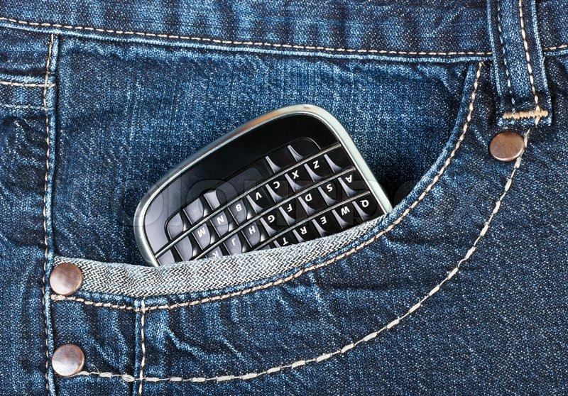 A Phone In Jeans Pocket Remove All Logos Characters Non Standard Button Names Stock Photo