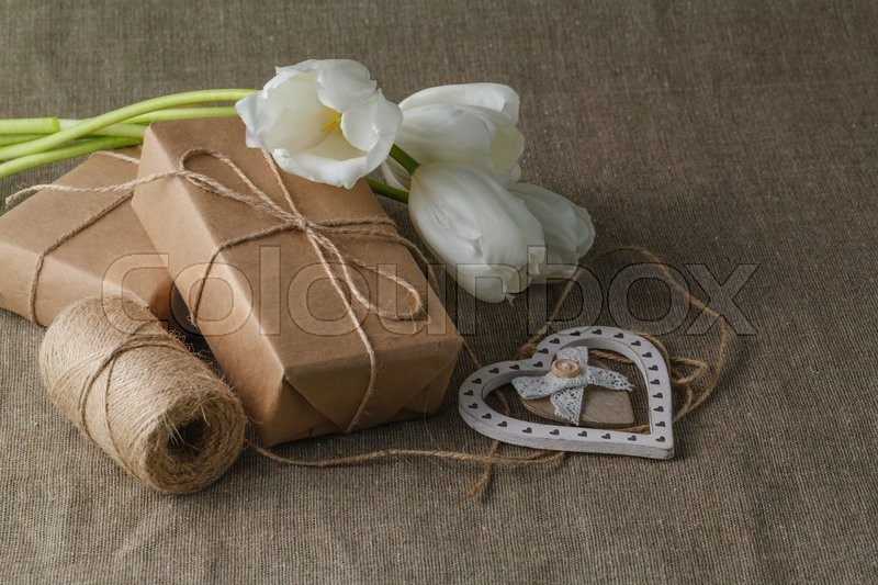 Vintage gift box brown paper wrapped with rope, stock photo