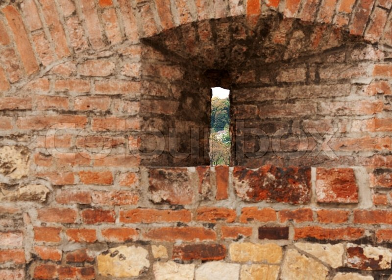 Loop-hole in the brick wall overlooking the forest   Stock ...
