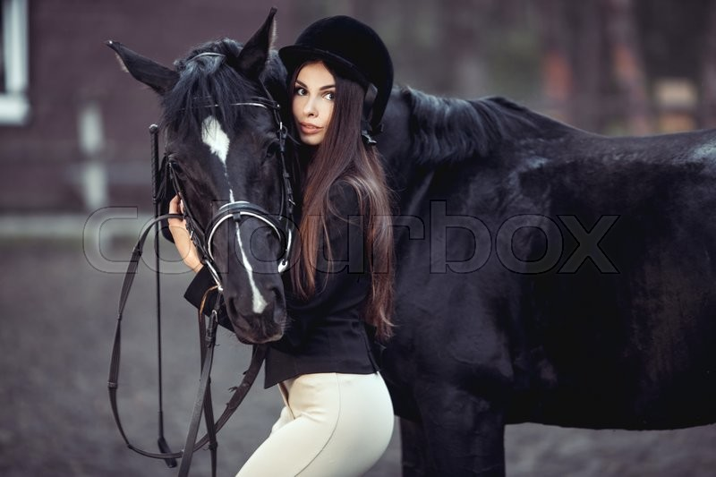 Beautiful young girl smile at her horse dressing uniform competition: outdoors portrait, stock photo