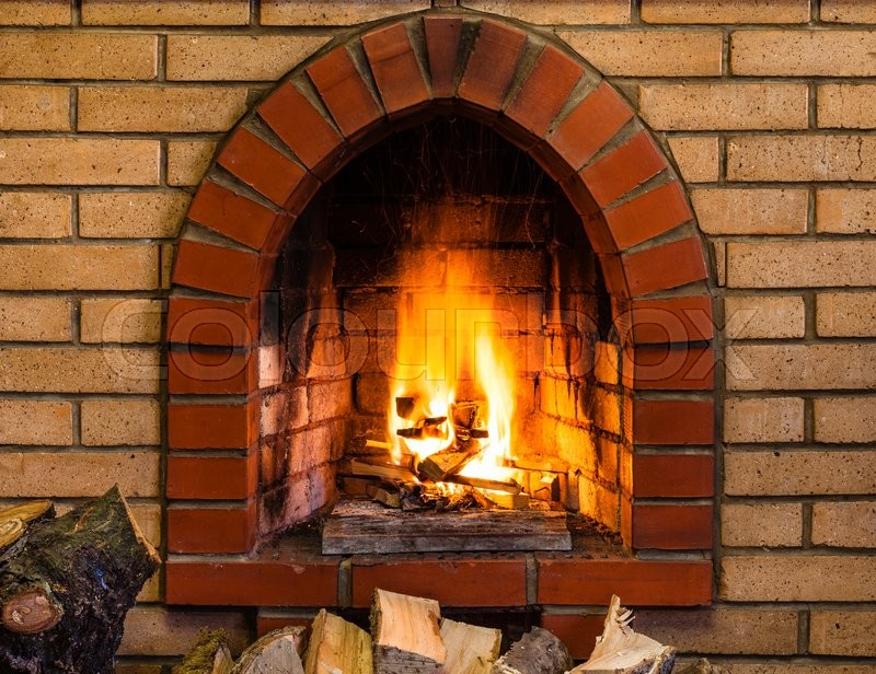 Open fire in indoor brick fireplace in country cottage | Stock ...