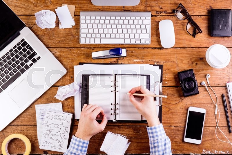 Business Person At Office Desk Writing And Working Smart
