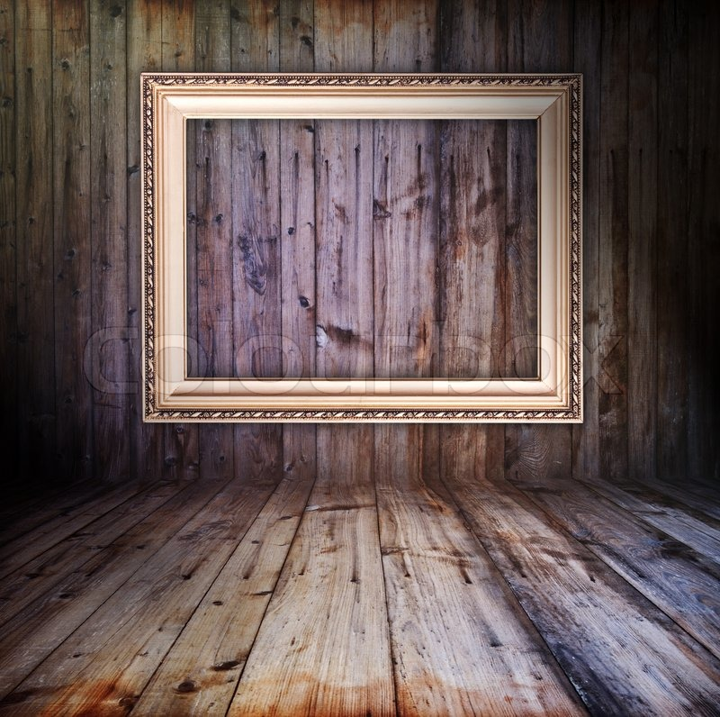 rusty vintage wooden interior with golden frame hanging on the wall