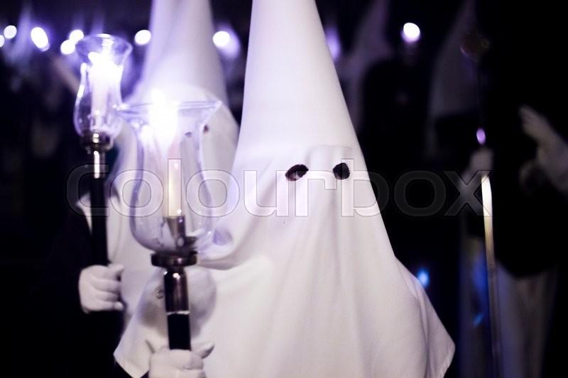 Easter catholic Spanish procession Semana Santa. Catholics wear pointed hoods in Andalusian culture, stock photo
