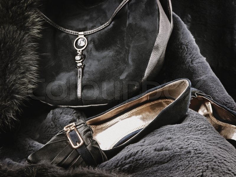 Woman wear accessories: fashionable handbag and shoes at fur, stock photo