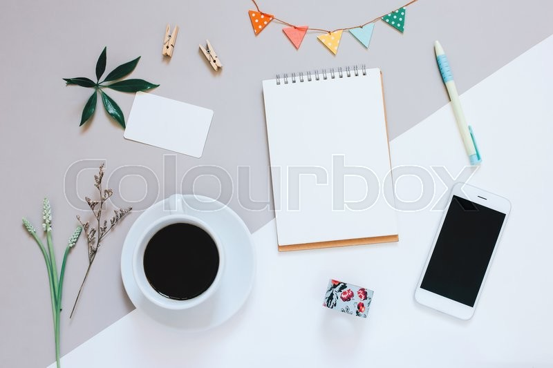 Creative flat lay design of cute workspace desk with notebook, coffee, smartphone and decorated cute craft with copy space background, minimal style , stock photo