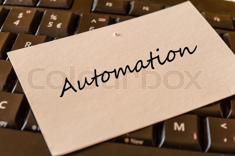 Automation - note on keyboard in the office, stock photo