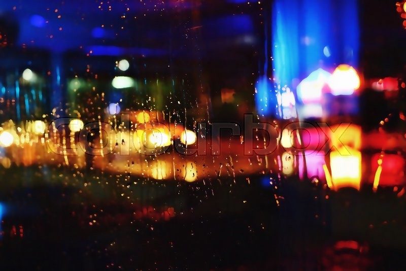 Photos night city made through glass. Street. Rain. Bokeh Lights Out Of Focus, stock photo
