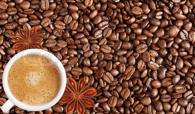 Close-up of coffee beans background and white coffee cup, stock photo