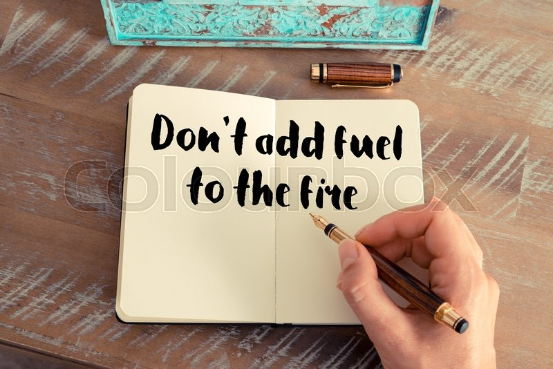 Handwritten quote dont add fuel to the fire as inspirational handwritten quote dont add fuel to the fire as inspirational concept image stock photo colourbox publicscrutiny Images