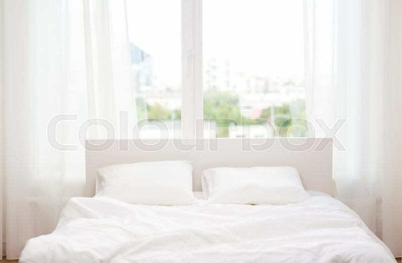 Rest, interior, comfort and bedding concept - bed at home bedroom, stock photo