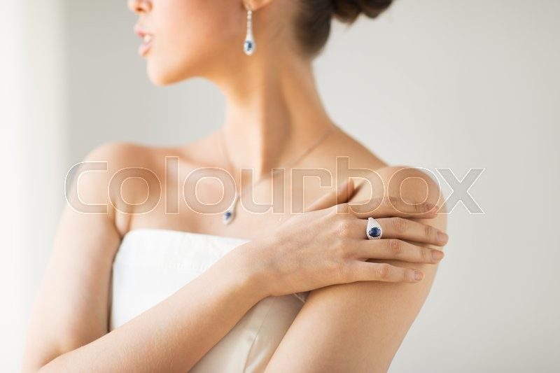 Glamour, beauty, jewelry and luxury concept - close up of beautiful woman with finger ring, stock photo