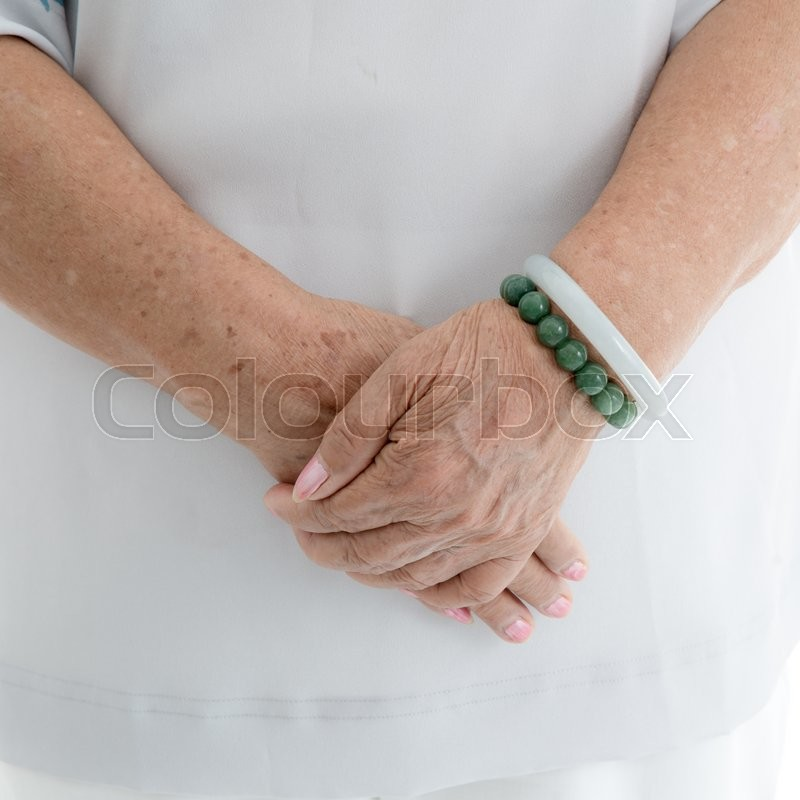 Aging process - old senior woman hands wrinkled skin, stock photo