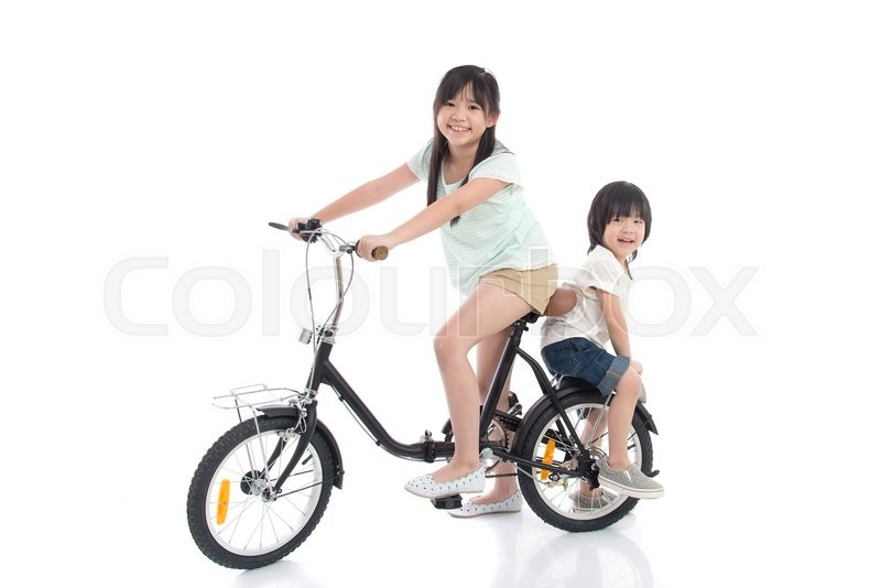 Asian children riding a bike on white background isolated, stock photo