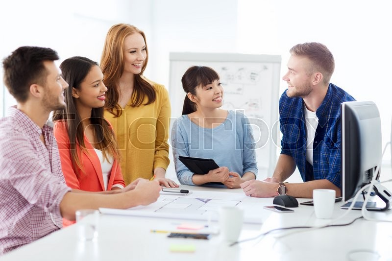 Business startup education and people concept happy creative business startup education and people concept happy creative architect team or students with blueprint working at office stock photo malvernweather Choice Image