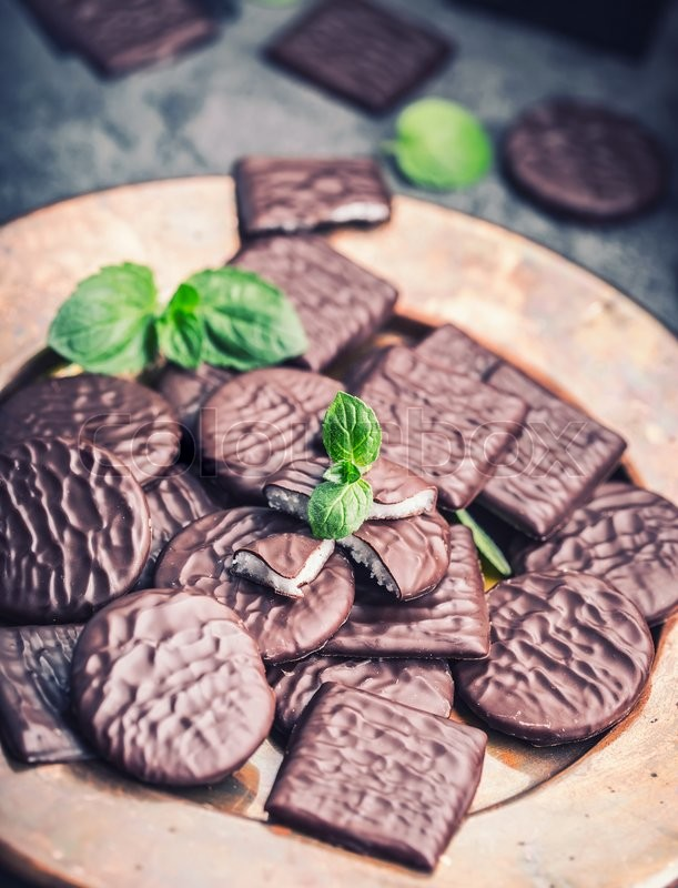 Chocolate peppermint cookies.Mint. Peppermint. Menthol. Black chocolate with peppermint cream. Black chocolate with mint stuffing. Menthol chocolate with mint leaves. Toned images, stock photo