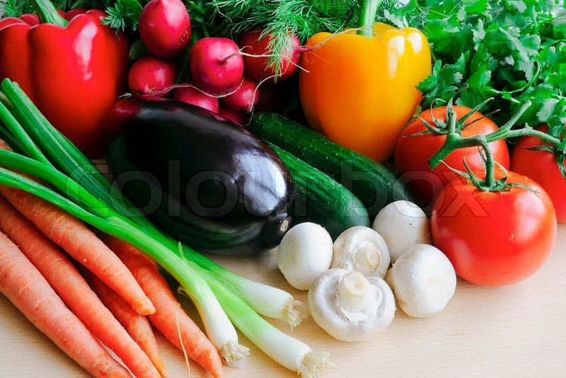 Stock image of 'Different colour vegetables lie on a table'