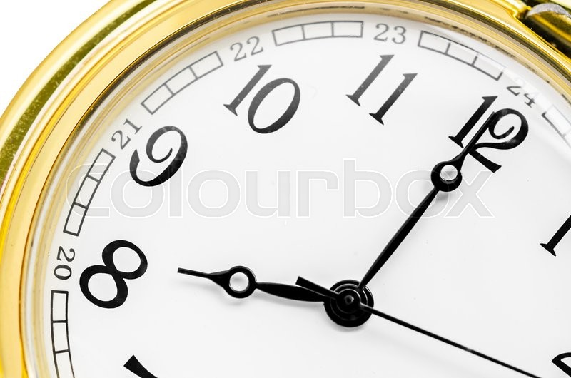 Close up gold clock face on white background, stock photo