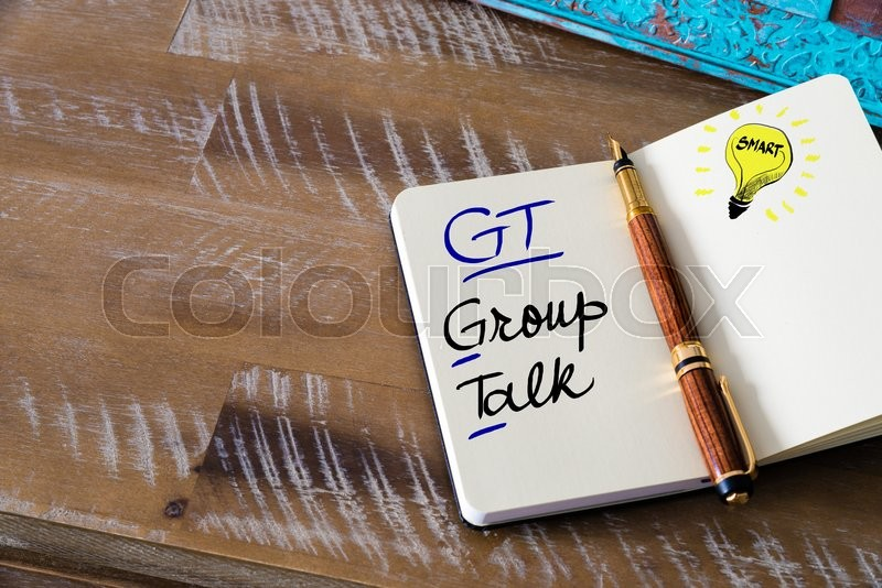 Conceptual Business Acronym GT Group Talk. Retro effect and toned image of a fountain pen on a notebook, stock photo